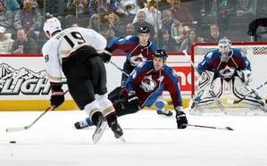 Hockey Player blocking shot