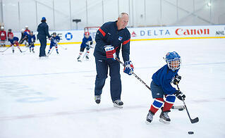 Are there benefits from attending a week-long hockey camp?