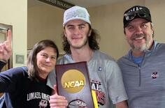 Josh Lopina and parents with NCAA trophy